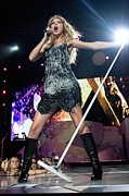 Gray Dress Posters - Taylor Swift On Stage For Taylor Swift Poster by Everett