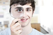 Student Section Framed Prints - Teenage Boy With Magnifying Glass Framed Print by