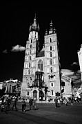 Town Square Posters - The 14th century gothic basilica of the Virgin Mary with tourists in rynek glowny town square krakow Poster by Joe Fox
