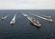 Carrier Posters - The Enterprise Carrier Strike Group Poster by Stocktrek Images