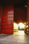 Light And Dark  Framed Prints - The Giant Red Doors To The Forbidden Framed Print by Justin Guariglia