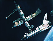 Space Shuttle Posters - The Space Shuttle Docked With A Space Station Poster by Stockbyte