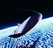 Space Shuttle Posters - The Space Shuttle Re-entering The Earths Atmosphere Poster by Stockbyte