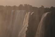 Victoria Falls Photos - The Zambezi River Plummets by Jason Edwards