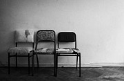 Empty Chairs Prints - Three Old Dirty Worn Out Chairs Against A White Wall In A Run Down Apartment In Argentina Print by Joe Fox