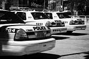 Cop Cars Posters - Toronto Police Squad Cars Outside Police Station In Downtown Toronto Ontario Canada Poster by Joe Fox