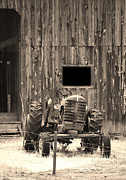 Ancient Tractor Prints - Tractor and The Barn Print by Donna Van Vlack