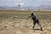 Logar Framed Prints - U.s. Army Soldier Launches An Rq-11 Framed Print by Stocktrek Images