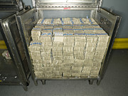 Enterprise Metal Prints - US Dollar Bills in a Bank Cart Metal Print by Adam Crowley