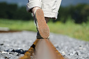 Screws Posters - Walking on railroad tracks Poster by Mats Silvan