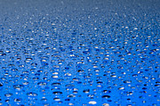 Liquid Posters - Water drops on a shiny surface Poster by Ulrich Schade