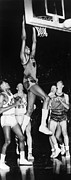 Dunk Photo Framed Prints - Wilt Chamberlain (1936-1999) Framed Print by Granger