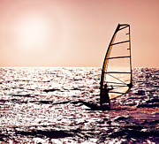 Surf Lifestyle Photos - Windsurfer silhouette over sea sunset by Anna Omelchenko
