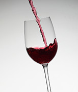 Wine Pouring Prints - Wine Pouring Into Wine Glass Print by Walter Zerla