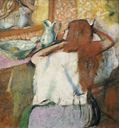 Mirror Reflection Posters - Woman at her Toilet Poster by Edgar Degas