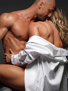 Suntanned Photos - Woman Embracing a Muscular Man by Oleksiy Maksymenko