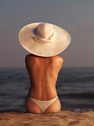 Sun Hat Prints - Woman on a Beach Print by Oleksiy Maksymenko