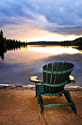 Water Fall Posters - Wooden chair at sunset on beach Poster by Elena Elisseeva