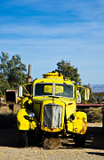 Yellow Barn Acrylic Prints - Yellow Water Truck Acrylic Print by Marius Sipa