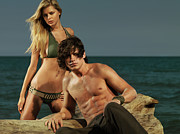 Young Man Posters - Young Beautiful Couple at the Beach Poster by Oleksiy Maksymenko