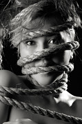 Mad Face Posters - Young Expressive Woman Tied in Ropes Poster by Oleksiy Maksymenko
