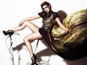 Exercising Photos - Young Woman in Long Dress on Exercise Bike by Oleksiy Maksymenko