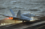 Carrier Framed Prints - An Fa-18c Hornet Launches Framed Print by Stocktrek Images