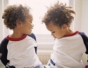 Communicating Photos - Identical Twin Boys by Ian Boddy
