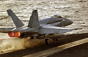 Carrier Posters - An Fa-18c Hornet Launches Poster by Stocktrek Images