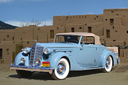 Taos Posters - 1936 Packard 12 at Taos Pueblo Poster by Jack Pumphrey