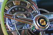 Steering Wheel Framed Prints - 1950 Chrysler New Yorker Coupe Steering Wheel Emblem Framed Print by Jill Reger