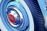 Car Carrier Photos - 1955 GMC Suburban Carrier Pickup Truck Wheel Emblem by Jill Reger