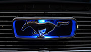 Blue Horse Framed Prints - 1966 Mustang Grill Emblem Glows Framed Print by Paul Ward