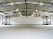 Storage Building Posters - A Large Empty Warehouse Or Covered Poster by Guang Ho Zhu