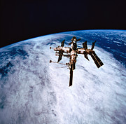 Progress Metal Prints - A Space Station In Orbit Above The Earth Metal Print by Stockbyte