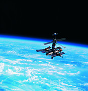 Alertness Photos - A Space Station Orbiting Above Earth by Stockbyte