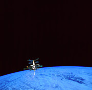 Alertness Photos - A Space Station Orbiting Above The Earth by Stockbyte
