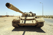 Muammar Gaddafi Prints - A T-55 Tank Destroyed By Nato Forces Print by Andrew Chittock