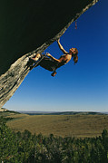 A Young Woman Climbing The Rock Feature Print by Bobby Model