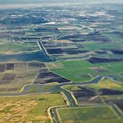Cultivation Prints - Aerial View of a River Passing Through Farmland Print by Eddy Joaquim