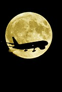 Aeroplane Silhouetted Against A Full Moon Print by David Nunuk