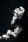 Gravity Prints - An Astronaut Anchored To A Mobile Foot Print by Stocktrek Images