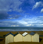 Cabins Posters - Beach huts under a stormy sky in Normandy Poster by Bernard Jaubert