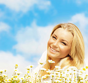 Chamomile Posters - Beautiful woman enjoying daisy field and blue sky Poster by Anna Omelchenko