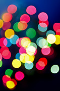Winter Night Prints - Blurred Christmas lights Print by Elena Elisseeva
