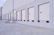 Rolling Doors Framed Prints - Distribution Center Bay Doors Framed Print by Dave & Les Jacobs