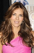Illuminates Framed Prints - Elizabeth Hurley At A Public Appearance Framed Print by Everett