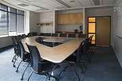 Empty Chairs Posters - Empty Boardroom Or Meeting Room In An Poster by Marlene Ford