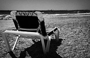 Lounger Prints - Empty Sun Lounger On Cyprus Tourist Organisation Municipal Beach In Larnaca Bay Republic Of Cyprus Print by Joe Fox