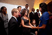 Michelle Obama Framed Prints - First Lady Michelle Obama Greets Framed Print by Everett